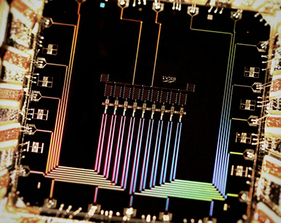 Photograph of a quantum-computing device showing the nine superconducting qubits